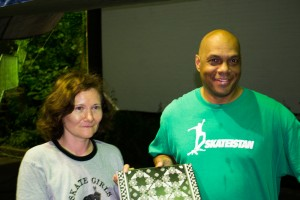 Bryan Ridgewood presents Tati with The Skateistan Book